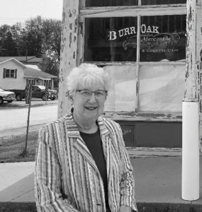Ferneva Brimacomb outside the Burr Oak Mercantile building before it became the Laura Ingalls Wilder Park & Museum